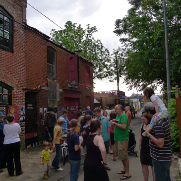 """Trinidad's Art in the Alley returns this Friday.  The semi-annual community arts event includes works by neighborhood artists, libations and music. Pictured above Art in the Alley 2011. Photo by Phil Hutinet for East City Art"""